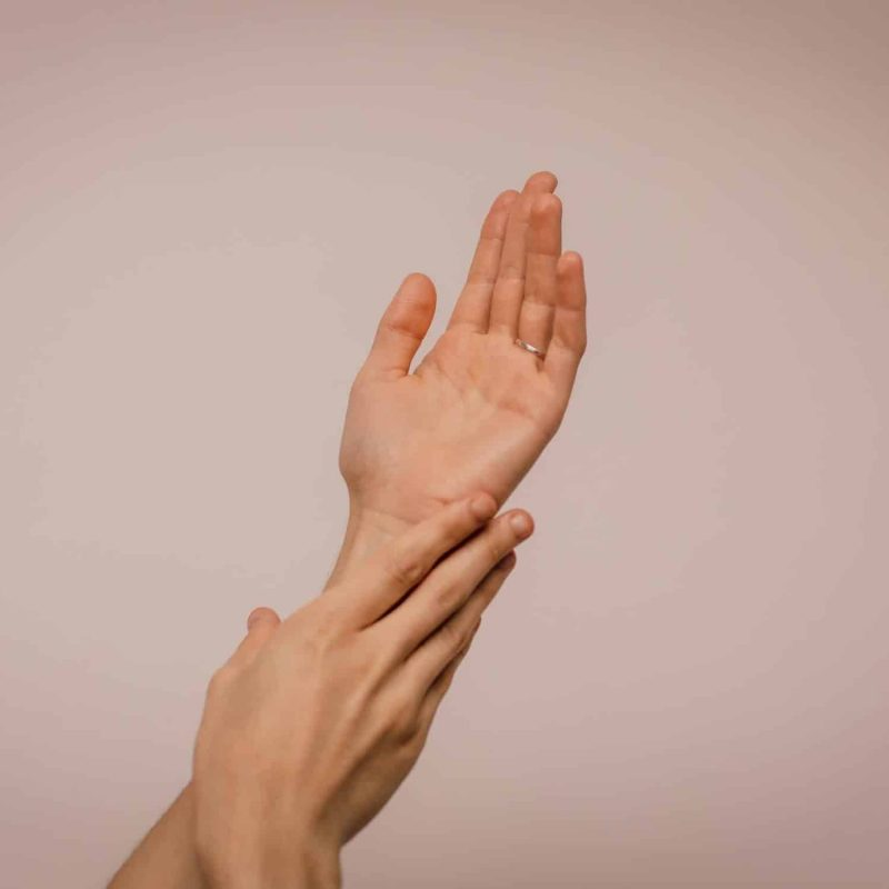Canva - Person Touching Hand